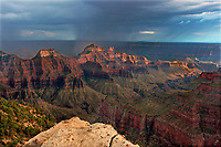 749220310 an extensive monsoon summer storm sweeps across wotan's throne brahma and zoraster temples and several other geological formations in this view from bright angel point near the lodge on the north rim of grand canyon national park arizona united states