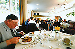 Jackie Healy-Rae enjoys his lunch in the Dail Restaurant in 2002.<br /> Photo Don MacMonagle