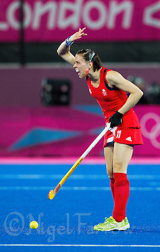 08 AUG 2012 - LONDON, GBR - Kate Walsh (GBR) of Great Britain urges players forward before a restart  during the London 2012 Olympic Games women's semi final match against Argentina at the Riverbank Arena in the Olympic Park, Stratford, London, Great Britain .(PHOTO (C) 2012 NIGEL FARROW)