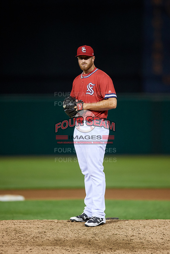 Syracuse Chiefs relief pitcher Austin L. Adams (12) gets ready to deliver a pitch during a game against the Buffalo Bisons on September 2, 2018 at NBT Bank Stadium in Syracuse, New York.  Syracuse defeated Buffalo 4-3.  (Mike Janes/Four Seam Images)
