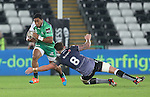 Connacht centre Bundee Aki skips past Ospreys number 8 Ieuan Jones.<br /> Guiness Pro12<br /> Ospreys v Connacht<br /> Liberty Stadium<br /> 31.10.14<br /> &copy;Steve Pope-SPORTINGWALES