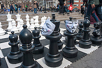 Giant Chess set, adorned with Guy Fawkes Masks, in Union Square used by OwS to symbolize the power struggle of the 99%..Occupy Wall Street marches from Washington Square to Union Square to support Universal Single Payer Healthcare in New York State