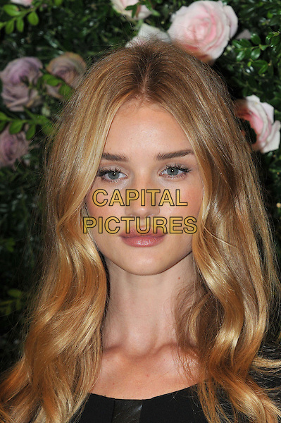 Rosie Huntington-Whiteley.launches her first ever lingerie collection for high street retailer M&S , inspired by the 1920s and her own work as an underwear model. Marks and Spencer, London, England..August 30th, 2012.headshot portrait black .CAP/BF.©Bob Fidgeon/Capital Pictures.