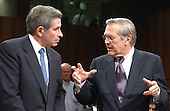 Washington, D.C. - March 23, 2004 -- United States Secretary of Defense Donald H. Rumsfeld, right, and Deputy Secretary of Defense Paul Wolfowitz, left, share some thoughts before giving testimony before The National Commission on Terrorist Attacks Upon the United States (also known as the 9-11 Commission) in Washington, D.C. on March 23, 2004.  <br /> Credit: Ron Sachs / CNP<br /> [RESTRICTION: No New York Metro or other Newspapers within a 75 mile radius of New York City]