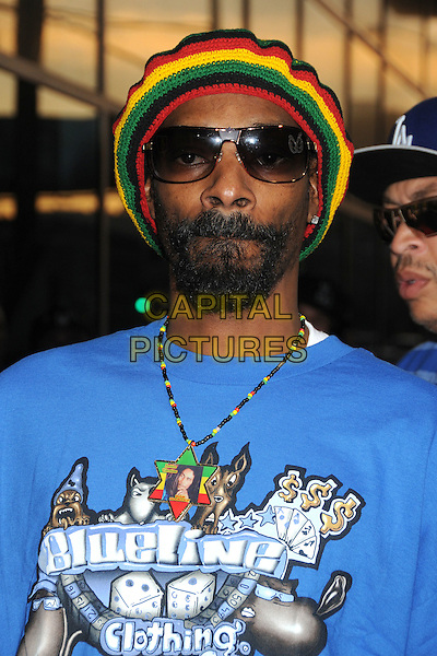 "Snoop Dogg (Calvin Cordozar Broadus, Jr.).""Marley"" Los Angeles Premiere held at Arclight Cinemas, Hollywood, California, USA..April 17th, 2012.headshot portrait blue sunglasses shades blueline clothing t-shirt print yellow green red hat beard facial hair.CAP/ADM/BP.©Byron Purvis/AdMedia/Capital Pictures."