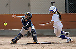 Western Nevada's Heather Septon scores past College of Southern Nevada catcher Nora Murphy during a college softball game in Carson City, Nev., on Thursday, March 14, 2013..Photo by Cathleen Allison