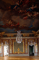 A dramatic scene painted by Francesco Martini and Carlo Zucchi covers the ceiling of the opulent throne room