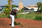 Damien McGrane plays his 2nd shot from the rough on the 18th hole during Day 3 of the Dubai World Championship, Earth Course, Jumeirah Golf Estates, Dubai, 27th November 2010..(Picture Eoin Clarke/www.golffile.ie)
