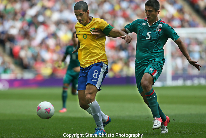 Brazil's Romulo Borges Monteiro is challenged in this tackle by Mexico's Darvin Chavez in the gold medal match at Wembley Stadium, London, UK. Saturday 11th August 2012. (Photo: Steve Christo)