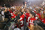 University of Wisconsin celebrates after winning the John Thompson Foundation Classic vs.  Fresno State at Camp Randall Stadium in Madison, WI, on 8/23/02. The Badgers beat Fresno State 23-21.  (Photo by David Stluka)