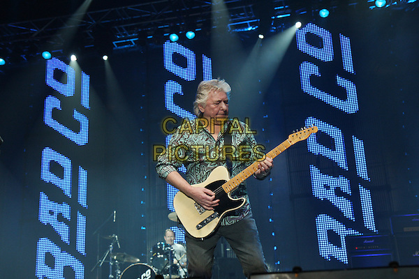 BAD COMPANY - Mick Ralphs.Performing live at Wembley Arena, London, England..April 11th, 2010.stage concert live gig performance music half length white brown shirt blue pattern guitar 3/4 jeans denim.CAP/MAR.© Martin Harris/Capital Pictures.