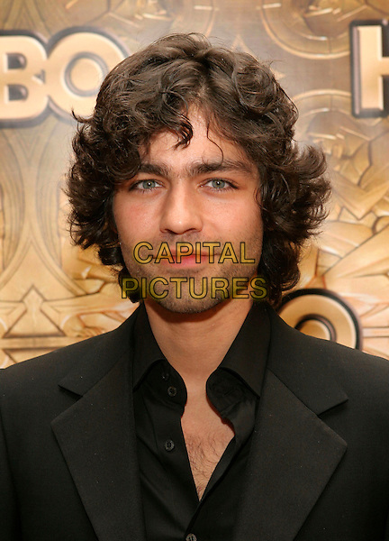 ADRIAN GRENIER.HBO Golden Globe Party After Party held at the Aqua Star Pool in the Beverly Hilton Hotel, Beverly Hills, California. .January 16th, 2006.Photo: Zach Lipp/AdMedia/Capital Pictures.Ref: ZL/ADM.headshot portrait facial hair.www.capitalpictures.com.sales@capitalpictures.com.© Capital Pictures.