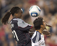 New England Revolution forward Shalrie Joseph (21) and Los Angeles Galaxy defender A.J. DeLaGarza (20) battle for a corner kick. In a Major League Soccer (MLS) match, the Los Angeles Galaxy defeated the New England Revolution, 1-0, at Gillette Stadium on May 28, 2011.