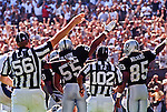 Oakland Raiders vs. Denver Broncos at Oakland Alameda County Coliseum Sunday, September 20, 1998.  Broncos beat Raiders  34-17.  Oakland Raiders linebacker James Folston (55) and wide receiver Terry Mickens (85) indicate ball change.