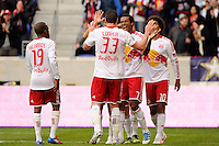 Kenny Cooper (33) of the New York Red Bulls celebrates scoring with Roy Miller (7) during the second half against the Colorado Rapids. The New York Red Bulls defeated the Colorado Rapids 4-1 during a Major League Soccer (MLS) match at Red Bull Arena in Harrison, NJ, on March 25, 2012.