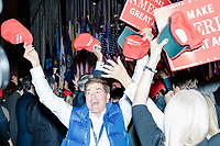 People celebrate in the ballroom in the Midtown Hilton at the election night victory rally for Republican presidential nominee Donald Trump, on Tues., Nov. 8, 2016, as it becomes clear that Trump will be the president-elect. Trump was named president-elect in the early hours of Nov. 9, 2016.