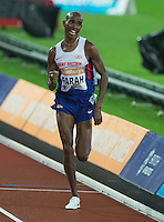 Mo FARAH of GBR crosses the line to win the Men's 3000m during The Sainsbury's Anniversary Games Diamond League Event at the Olympic Park, London, England on 24 July 2015. Photo by Andy Rowland.