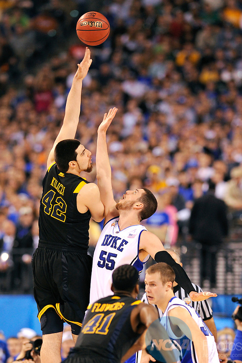 3 APR 2010: Deniz Kilicli (42) of West Virginia puts up a shot in front of Brian Zoubek (55) of Duke during the semi final game between Duke and West Virginia at the Men's Final Four Basketball Championships held at Lucas Oil Stadium in Indianapolis, IN. Duke defeated West Virginia 78-57 to advance to the national championship. Ryan McKee/NCAA Photos