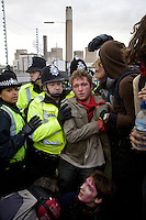 Police clash with climate activists as they take direct action against the coal fired power station at Ratcliffe on Soar, south of Nottingham. The power station, owned by E.ON, is the third largest emitter of greenhouse gases in the UK.