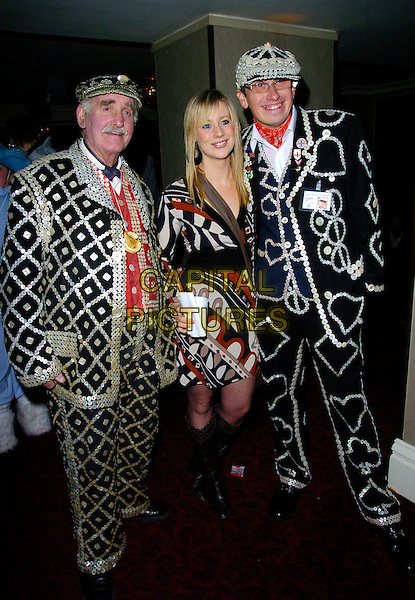 KELLIE SHIRLEY with MAD HATTERS.At The Mad Hatters Tea Party, Grosvenor House, Park Lane, London, England, January 28th 2007..full length kelly black and white brown orange patterned print dress knee high boots fancy dress costumes.CAP/CAN.©Can Nguyen/Capital Pictures
