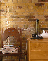 With all traces of plaster removed, the old brick walls in this Victorian house add character, texture and pattern