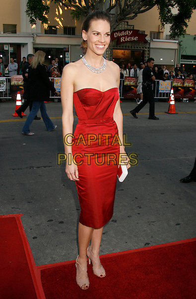 "HILARY SWANK.""The Reaping"" Los Angeles Premiere held at Mann's Village Theatre, Hollywood, California, USA..March 29th, 2007.full length red dress belt white clutch purse diamond necklace strapless .CAP/ADM/RE.©Russ Elliot/AdMedia/Capital Pictures"
