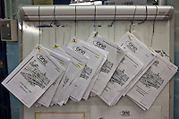 Induction booklets, in many languages, for new prisoners on E wing of HMP Wandsworth. London, United Kingdom. Wandsworth is the largest prison in the UK, currently able to hold 1665 prisoners. Alongside Liverpool, which is of similar size, it is one of the largest prisons in Western Europe. The prison was built in 1851.