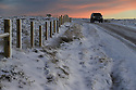 14/01/16<br /> <br /> As temperatures begin to plummet under clear skies, cars drive along a road covered in sheet ice on Axe Edge in the Derbyshire Peak District near Buxton .<br /> <br /> All Rights Reserved: F Stop Press Ltd. +44(0)1335 418365   +44 (0)7765 242650 www.fstoppress.com