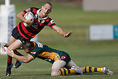 Jason McKenzie of the Wyong Roos tackles Matt Evans of the North Sydney Bears during the first trail game of the 2013 NSW Cup season at Morrie Breen Oval on February 9, 2013 in Wyong, Australia. (Photo by Paul Barkley/LookPro)