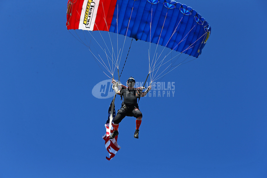 Mar 15, 2015; Gainesville, FL, USA; A sky diver parachutes in with the American flag prior to eliminations at the Gatornationals at Auto Plus Raceway at Gainesville. Mandatory Credit: Mark J. Rebilas-
