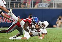 NWA Democrat-Gazette/CHARLIE KAIJO Arkansas Razorbacks quarterback Nick Starkel (17) is sacked by an Ole Miss defender during the fourth quarter of a football game, Saturday, September 7, 2019 at Vaught-Hemingway Stadium in Oxford, Miss.