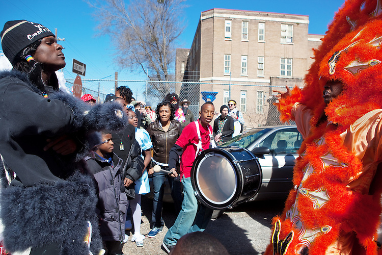 The Wild Man of the 7th Ward Creole Hunters, left, confronts Santana Montana of the Monogram Hunters in the Treme neighborhood of New Orleans on Mardi Gras day, February 16, 2010.