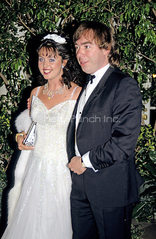 English composer Andrew Lloyd Webber, right, and his wife, Sarah Brightman, left, arrive at the White House in Washington, DC for the State Dinner hosted by United States President Ronald Reagan and first lady Nancy Reagan honoring Prime Minister Margaret Thatcher of Great Britain at the White House in Washington, DC on November 16, 1988.<br /> Credit: Ron Sachs / CNP/MediaPunch