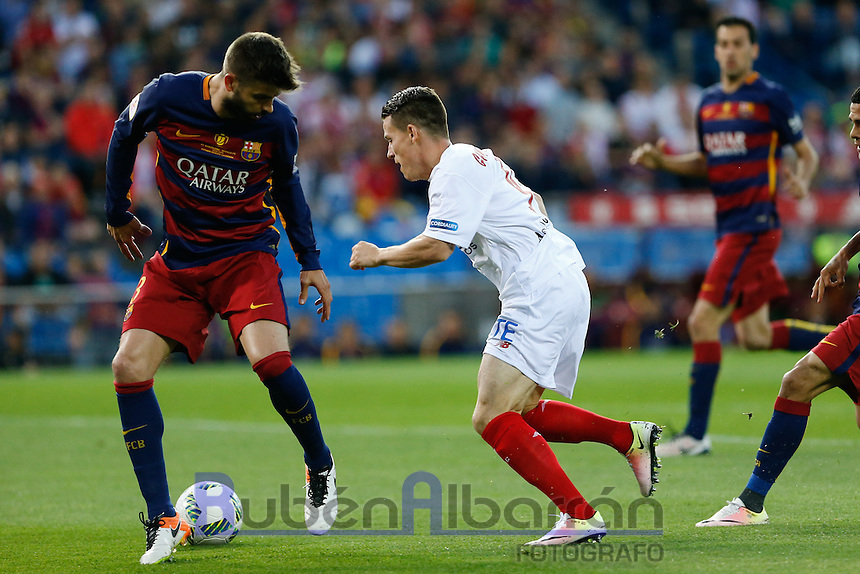 FC Barcelona´s  defense Gerard Pique and Sevilla´s forward Gameiro during the Final of Copa del Rey match between FC Barcelona and SevillaFC at the Vicente Calderon Stadium in Madrid, Sunday, May 22, 2016.