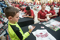 NWA Democrat-Gazette/BEN GOFF @NWABENGOFF<br /> Logan Bates, 7, of Clinton, checks out the autographs on his baseball while making his way around the tables Saturday, Feb. 9, 2019, during Arkansas baseball's annual Meet the Razorbacks Day at Northwest Arkansas Mall in Fayetteville.