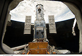 In Earth Orbit - May 13, 2009 -- The Hubble Space Telescope stands tall in the cargo bay of the Space Shuttle Atlantis following its capture and lock-down in Earth orbit..Credit: NASA via CNP