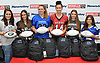Six varsity female football players from Long Island pose for a group picture at Modell's Sporting Goods in Farmingdale on Monday, Nov. 21, 2017. Appearing are, from left, Cayleigh Kunnmann of Bay Shore, Alexis Saladino of Newfield, Amber Seifts of Centereach, Hannah Martin of Patchogue-Medford, Megan Benzing of Mepham and Mia Advocate of Calhoun.