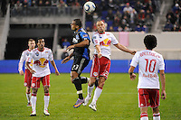 Eduardo (23) of the San Jose Earthquakes and Joel Lindpere (20) of the New York Red Bulls go up for a header. The San Jose Earthquakes defeated the New York Red Bulls 3-1, (3-2) on aggregate during the 2nd leg of the Major League Soccer (MLS) Eastern Conference Semifinals at Red Bull Arena in Harrison, NJ, on November 04, 2010.