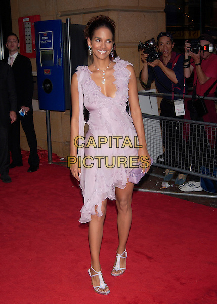 "HALLE BERRY.""Catwoman"" film premiere arrivals.Vue Cinema, Leicester Square.London 3 August 2004.full length, purple, lilac ruffles, layered dress.www.capitalpictures.com.sales@capitalpictures.com.©Capital Pictures"