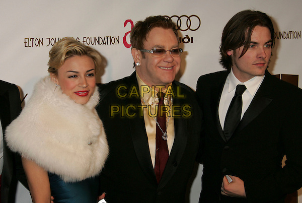 SAMAIRE ARMSTRONG, ELTON JOHN & KEVIN ZEGERS.The 14th Annual Elton John AIDS Foundation Oscar Party, Co-hosted by Audi, Chopard and VH1 - Red Carpet, held at the Pacific Design Center, Hollywood, California, USA..March 5th, 2006.Photo: Russ Elliot/Admedia/Capital Pictures.Ref: RE/ADM.half length white fur sunglasses shades  .www.capitalpictures.com.sales@capitalpictures.com.© Capital Pictures.