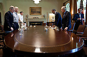United States President Barack Obama and Vice President Joe Biden meet with Congressional leaders in the Cabinet Room of the White House to discuss ongoing efforts to find a balanced approach to the debt limit and deficit reduction, Saturday, July 23, 2011. Pictured, from left, are: U.S. Senate Minority Leader Mitch McConnell (Republican of Kentucky), U.S. House Minority Leader Nancy Pelosi (Democrat of California), OMB Director Jack Lew, U.S. Senate Democratic leader Harry Reid (Democrat of Nevada), and U.S. House Speaker John Boehner (Republican of Ohio). .Mandatory Credit: Pete Souza - White House via CNP