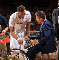 Virginia guard Justin Anderson (1) talks with Virginia head coach Tony Bennett during the game Jan. 7, 2015, in Charlottesville, Va. Virginia defeated NC State  61-51.
