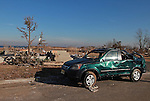 An abondoned SUV sits amongst the destruction from Superstorm Sandy on Brook Avenue in Union Beach, New Jersey.  Photo By Bill Denver