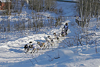 Saturday, February 24th, Knik, Alaska.  Jr. Iditarod musher Amanda Olson on the trail shortly after leaving the Knik start