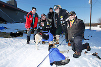 Volunteer vets gather for a group photo at the Shageluk village checkpoint during the 2011 Iditarod race..
