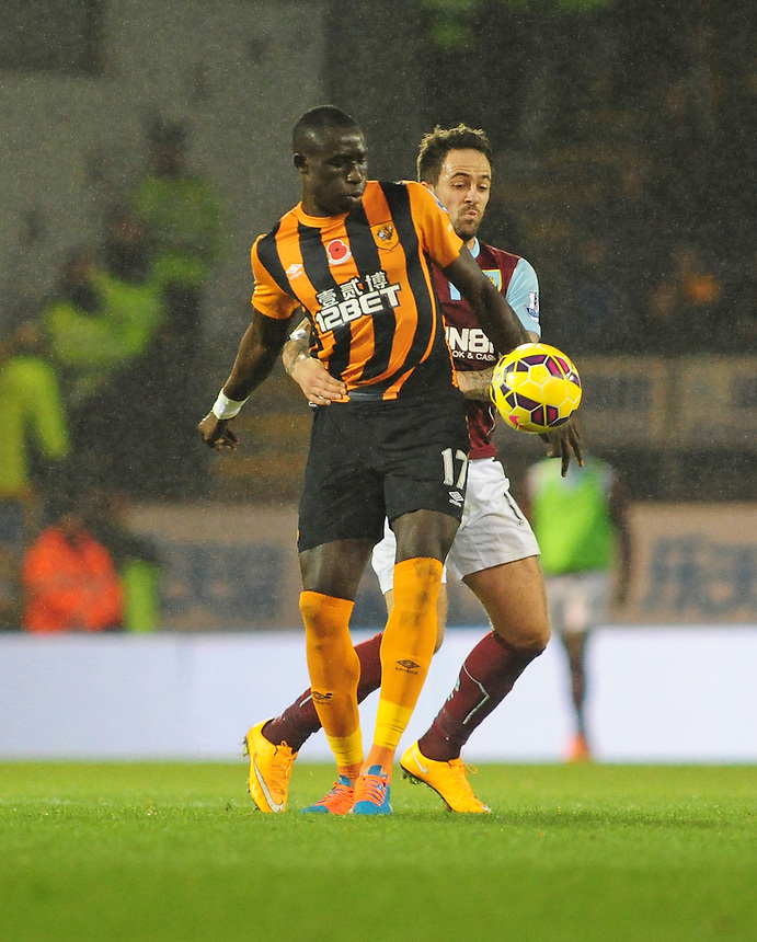 Hull City's Mohamed Diame shields the ball from Burnley's Danny Ings<br /> <br /> Photographer Chris Vaughan/CameraSport<br /> <br /> Football - Barclays Premiership - Burnley v Hull City - Saturday 8th November 2014 - Turf Moor - Burnley<br /> <br /> &copy; CameraSport - 43 Linden Ave. Countesthorpe. Leicester. England. LE8 5PG - Tel: +44 (0) 116 277 4147 - admin@camerasport.com - www.camerasport.com
