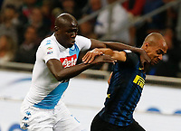 Napoi's Kalidou Koulibaly and Joao Mario  of Inter during the  italian serie a soccer match,between Inter FC  and SSC Napoli      at  the San Siro   stadium in Milan  Italy , April  30, 2017