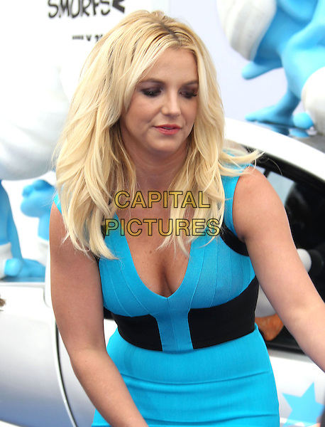 Britney Spears <br /> &quot;Smurfs 2&quot; Los Angeles Premiere held at the Regency Village Theatre, Westwood, California, USA. <br /> July 28th, 2013 <br /> half length blue black dress bending leaning cleavage turquoise <br /> CAP/ADM/RE<br /> &copy;Russ Elliot/AdMedia/Capital Pictures
