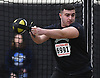 Corey Hill of Farmingdale generates momentum for a weight throw during the event's Nassau County championship and state qualifier at St. Anthony's High School on Monday, Feb. 6, 2017.