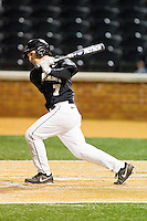 Joey Rodriguez (7) of the Wake Forest Demon Deacons follows through on his swing against the West Virginia Mountaineers at Wake Forest Baseball Park on February 24, 2013 in Winston-Salem, North Carolina.  The Demon Deacons defeated the Mountaineers 11-3.  (Brian Westerholt/Four Seam Images)